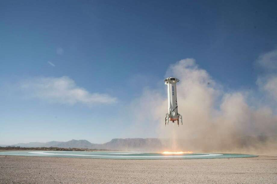 In this photo provided by Blue Origin, the New Shepard booster lands in west Texas during a test on Tuesday, Dec. 12, 2017. Named after the first American in space, Alan Shepard, the spacecraft made a 10-minute suborbital flight. (Blue Origin via AP) Photo: HONS / Blue Origin