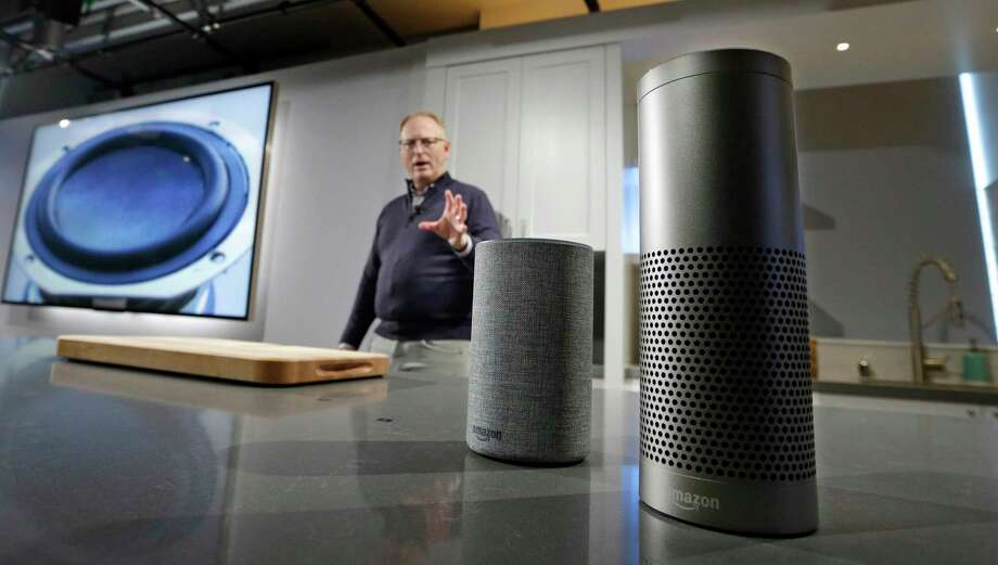 FILE - In this Wednesday, Sept. 27, 2017, file photo, David Limp, senior vice president of Devices and Services at Amazon, displays a new Echo, left, and an Echo Plus during an event announcing several new Amazon products by the company, in Seattle. Photo: Elaine Thompson, AP / Copyright 2017 The Associated Press. All rights reserved.