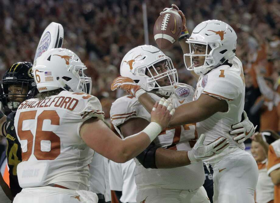 Texas Longhorns wide receiver John Burt (1) celebrates his touchdown catch with his teammates during the Academy Sports + Outdoors Texas Bowl against Missouri at NRG Stadium on Wednesday, Dec. 27, 2017, in Houston. Photo: Elizabeth Conley, Houston Chronicle / © 2017 Houston Chronicle