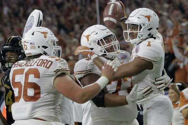 Texas Longhorns wide receiver John Burt (1) celebrates his touchdown catch with his teammates during the Academy Sports + Outdoors Texas Bowl against Missouri at NRG Stadium on Wednesday, Dec. 27, 2017, in Houston.