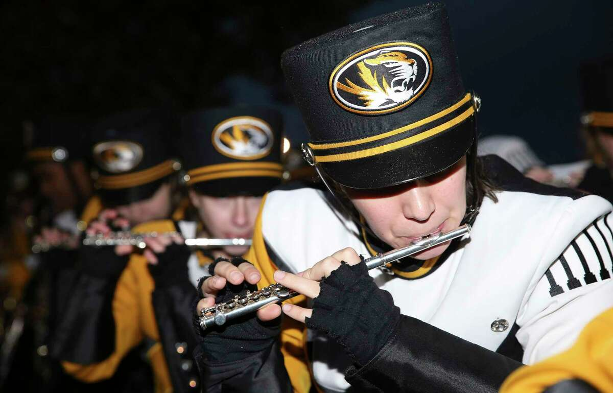 Missouri band members perform during the Missouri Spirit Walks before the 2017 Academy Sports + Outdoors Texas Bowl at NRG Stadium on Wednesday, Dec. 27, 2017, in Houston.