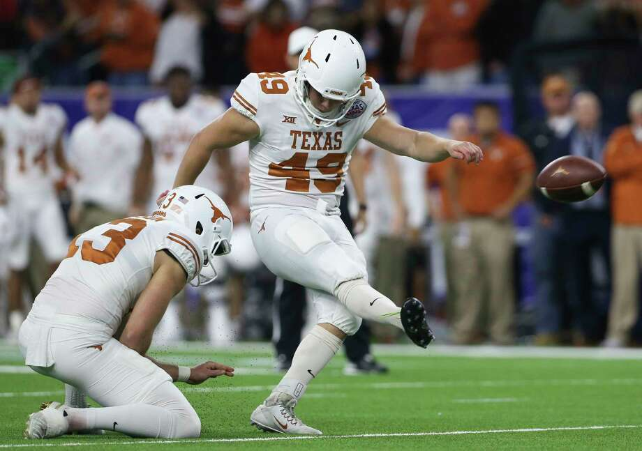 Joshua Rowland, kicking an extra point in the Texas Bowl, is back for the Longhorns. Photo: Yi-Chin Lee, Houston Chronicle / © 2017  Houston Chronicle