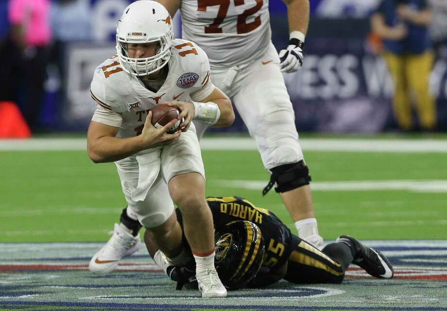 Texas Longhorns quarterback Sam Ehlinger (11) is brought down by Missouri Tigers defensive lineman Jordan Harold (55) while running the ball during the fourth quarter of the 2017 Academy Sports + Outdoors Texas Bowl game at NRG Stadium on Wednesday, Dec. 27, 2017, in Houston. The Texas Longhorns defeated the Missouri Tigers 33-16. Photo: Yi-Chin Lee, Houston Chronicle / © 2017  Houston Chronicle