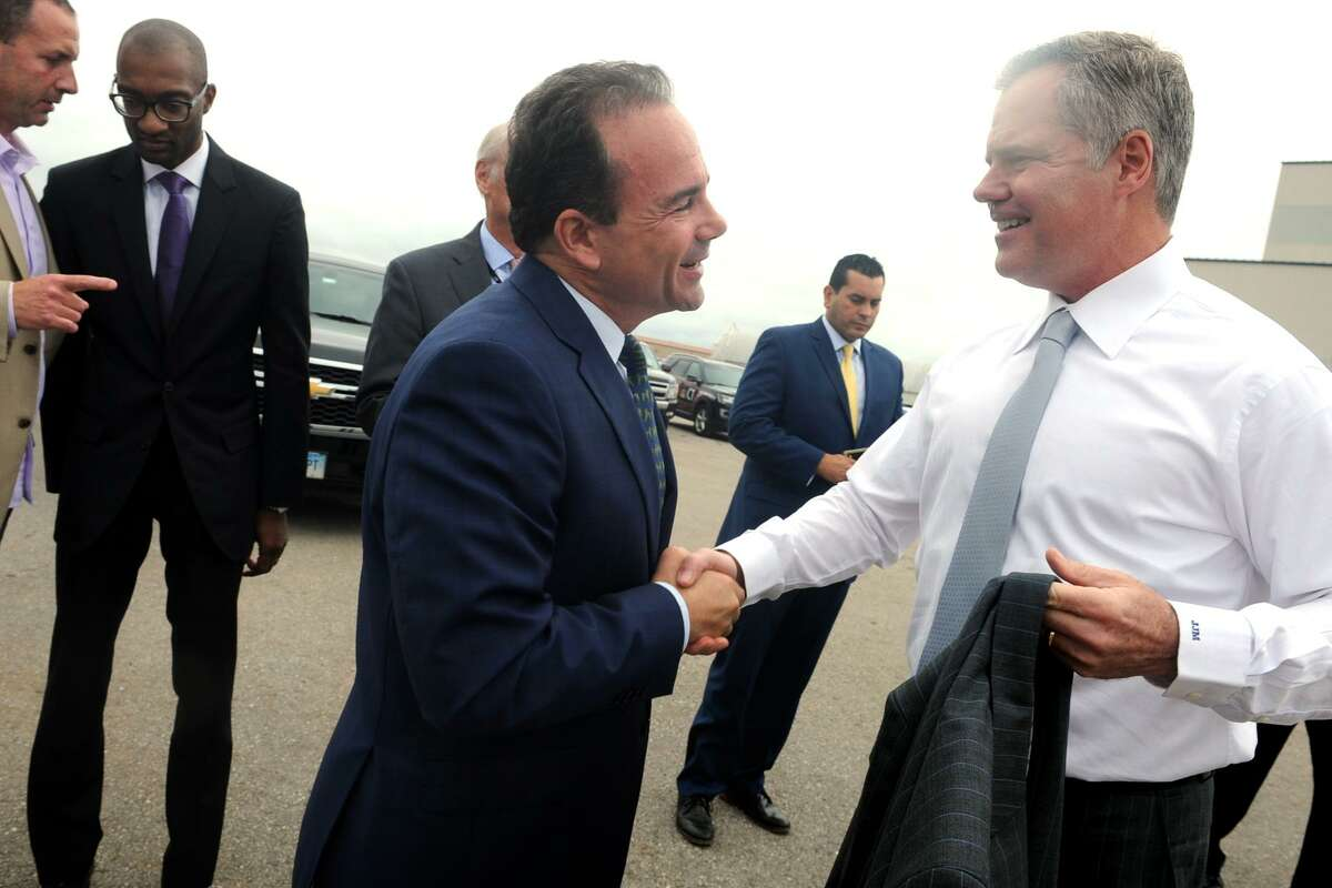 Mayor Joe Ganim greets Jim Murren, Chairman and Chief Executive Officer of MGM Resorts prior to the announcement of MGM Bridgeport, a new waterfront casino and entertainment complex to be built in Bridgeport, Conn. Sept. 18, 2017.