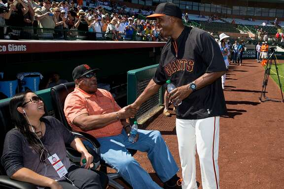 Mar 10, 2014; Scottsdale, AZ, USA; San Francisco Giants former outfielder Barry Bonds (right) greets Willie McCovey during batting practice prior to the game against the Chicago Cubs at Scottsdale Stadium. Mandatory Credit: Mark J. Rebilas-USA TODAY Sports