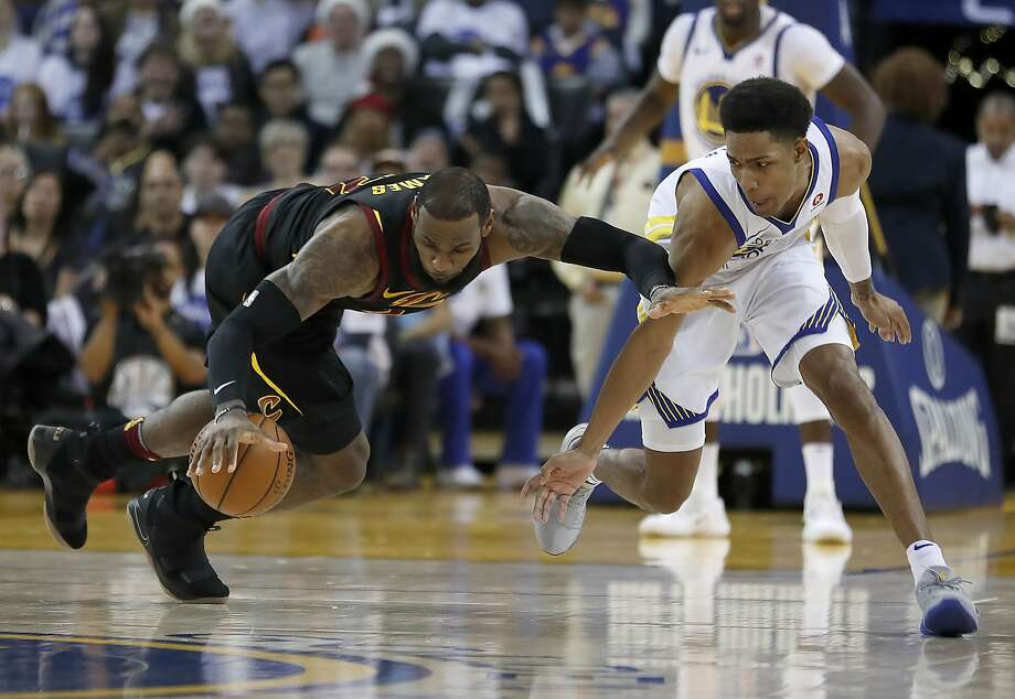 Cleveland Cavaliers forward LeBron James (23) battles for the ball against Golden State Warriors guard Patrick McCaw (0) during the second half of an NBA basketball game in Oakland, Calif., Monday, Dec. 25, 2017. The Warriors won 99-92. (AP Photo/Tony Avelar) Photo: Tony Avelar, Associated Press