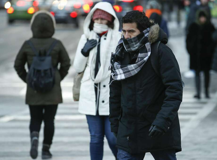 Pedestrians walk along Michigan Avenue in Chicago. Forecasters warned of hypothermia and frostbite. Photo: Kamil Krzaczynski, Getty Images