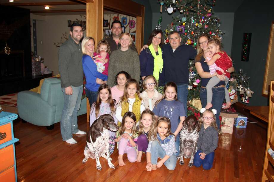 """The Putman family of Caseville Township recently reflected on what Christmas means to them. The 26-member family living under one roof is awaiting news of whether TLC will carry their reality television show, """"Meet the Putmans,"""" for a second season in 2018. Photo: Brenda Battel, Huron Daily Tribune"""