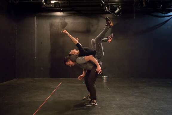 """Soren Santos (bottom) and Stephanie DeMott rehearsing in Mugwumpin's """"In Event of Moon Disaster."""" on Tuesday, Dec. 19, 2017 in San Francisco, Calif."""
