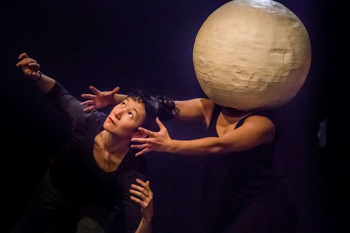 """Erin Mei-Ling Stuart and Isa Musni (in moon) rehearse in Mugwumpin's """"In Event of Moon Disaster."""" on Tuesday, Dec. 19, 2017 in San Francisco, Calif."""