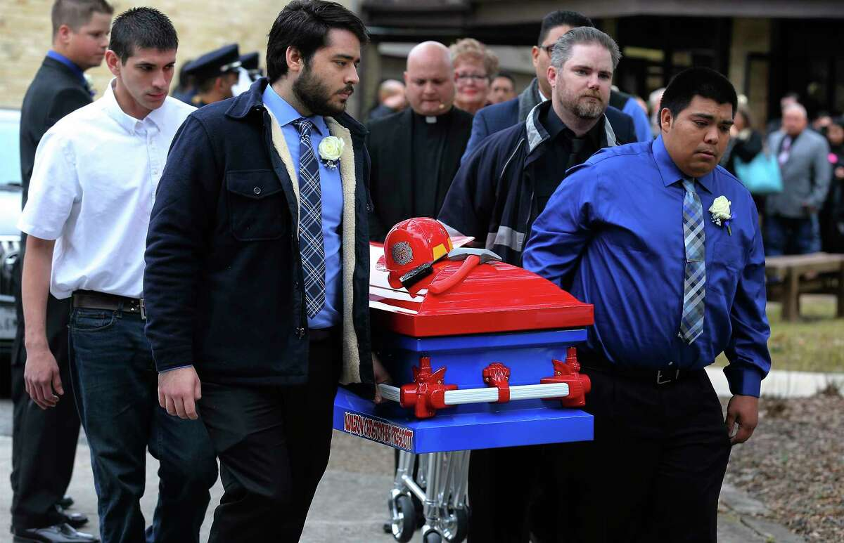 Pallbearers carry the firefighter-themed casket of six-year-old Kameron Prescott after a church service on Thursday, Dec. 28, 2017. Kameron was killed in his Schertz trailer home by Bexar County sheriff's deputies' gunfire last week. About 600 people attended the service which was held at United Methodist Church in Universal City and his burial followed at Chapel Hill Memorial Park.