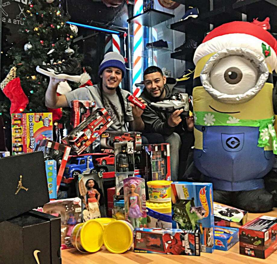 """The second annual Finesse Cuts Christmas drive gathered toy donations that were given to families in Middletown and children admitted to Middlesex Hospital during Christmas. """"The community worked together well on this one once again. We received plenty of toys and even decided to donate sneakers,"""" said owner Ernesto Varga Jr. His salon is in the city's North End at 578 Main St. Photo: Contributed Photo"""
