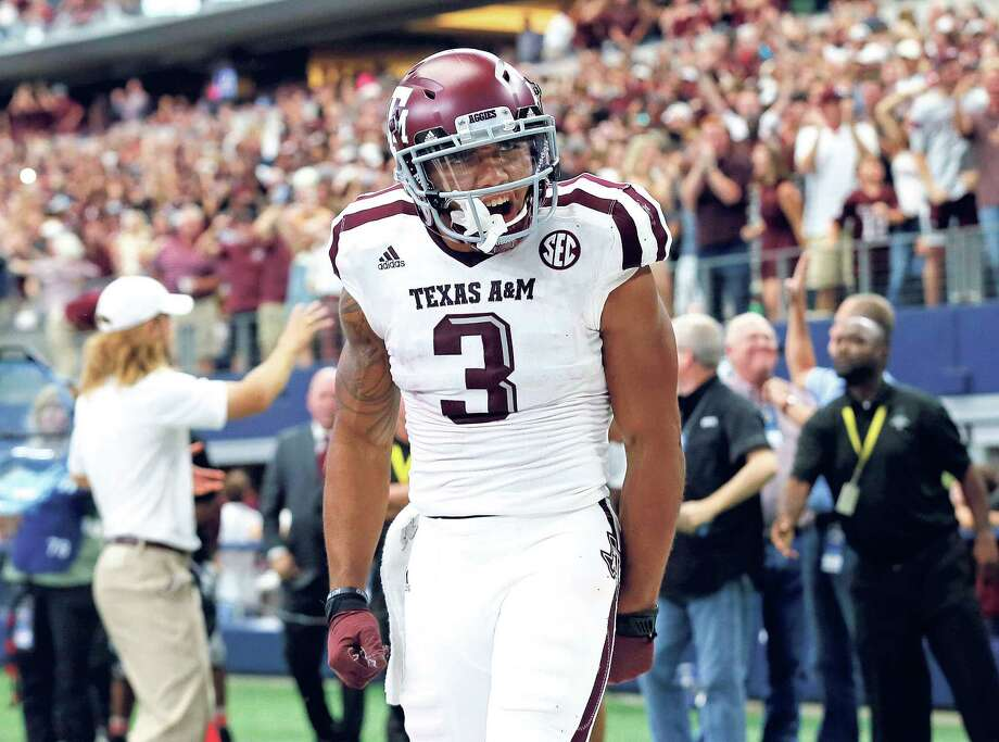 Texas A&M wide receiver Christian Kirk (3) celebrates catching a touchdown pass in overtime of an NCAA college football game against Arkansas on Saturday, Sept. 23, 2017, in Arlington, Texas. (AP Photo/Tony Gutierrez) Photo: Tony Gutierrez, STF / Copyright 2017 The Associated Pr