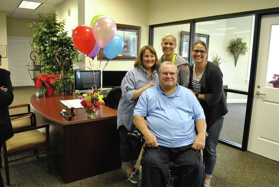Tomball has named Steven Vaughan, front, as its citizen of the year. Vaughan was instrumental in forming the Tomball Economic Development        Corp. back in 1994 and working to get it approved by voters. Photo: Greater Tomball Area Chamber Of Commerce