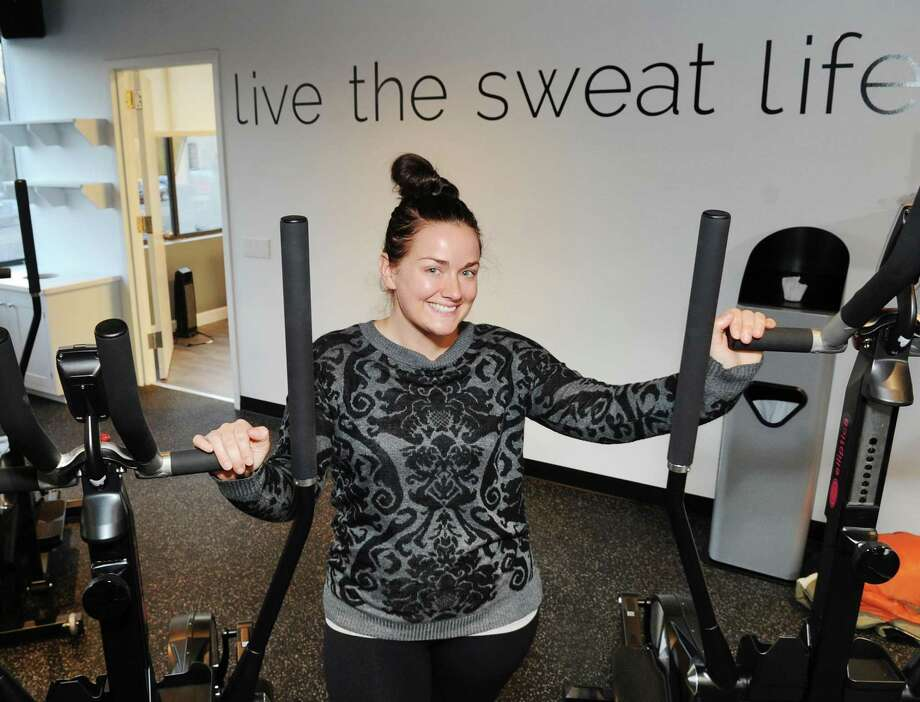 Laura Laboissonniere, owner of Elliptica, an elliptical-based boutique fitness studio posed in her studio in Greenwich, Conn., Tuesday, Dec. 19, 2017. Photo: Bob Luckey Jr. / Hearst Connecticut Media / Greenwich Time