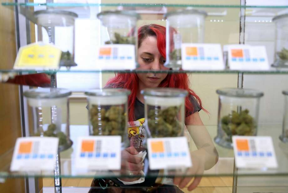 Chelsi Lee cleans a shelf as preparations are made for the Jan. 1 kickoff of recreational cannabis sales in California at SPARC in Sebastopol, Calif., on Wednesday, December 27, 2017. Photo: Scott Strazzante, The Chronicle
