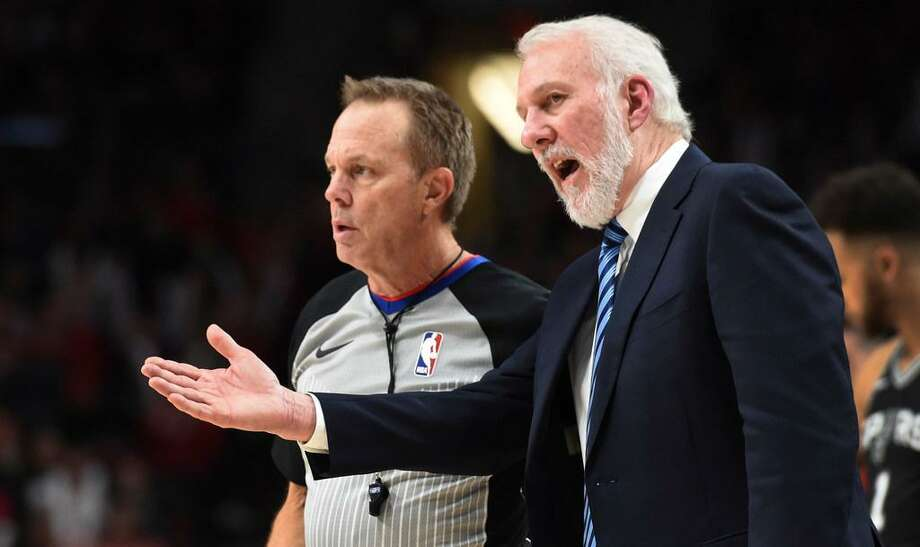 Spurs coach Gregg Popovich talks to referee Bill Spooner during a Dec. 20, 2017 game in Portland, Ore. Popovich has been outspoken off the court too this year, talking at length about political and social issues. Photo: Steve Dykes /APPhoto