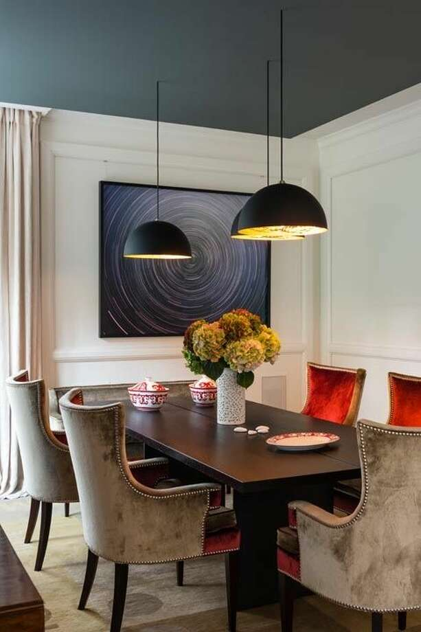 """6) Moodier Palettes """"We're using richer color palettes with different colored metals, such as deeper gem tones, velvet upholstery and sleek black and white marbles,"""" says Karen Asprea of Whitehall Interiors. """"Using lacquered wall panels where you might have seen wood paneling in the past allows for more flexibility in terms of color and finish, and really adds to the environment of any space.""""  Photo: Getty Images"""