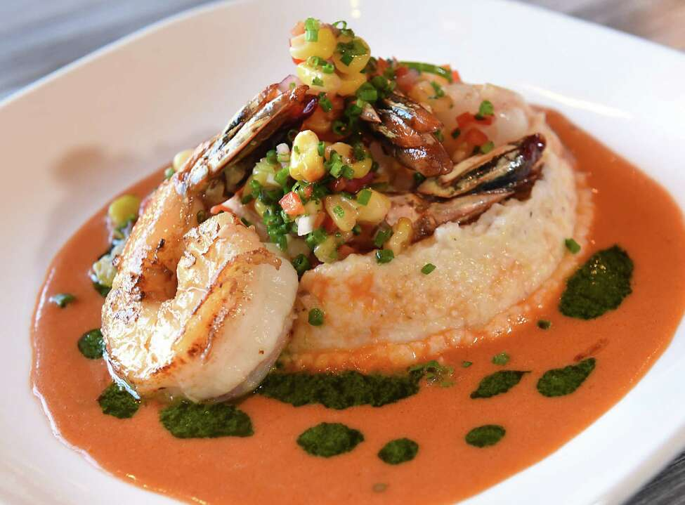 Shrimp and hominy grits with tomato chipotle cream, parsley emulsion and roasted corn salsa at The Cuckoo's Nest on Thursday, Dec. 21, 2017 in Albany N.Y. (Lori Van Buren / Times Union)
