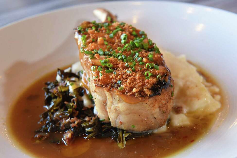 Apple smoked double cut pork chop with collard greens, cornbread crumble and jam at The Cuckoo's Nest on Thursday, Dec. 21, 2017 in Albany N.Y. (Lori Van Buren / Times Union)