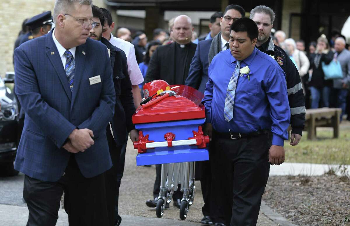 Pallbearers carry the firefighter-themed casket of six-year-old Kameron Prescott after a church service on Thursday, Dec. 28, 2017. Kameron was killed in his Schertz trailer home by Bexar County sheriff's deputies' gunfire last week. About 600 people attended the service which was held at United Methodist Church in Universal City and his burial followed at Chapel Hill Memorial Park. (Kin Man Hui/San Antonio Express-News)