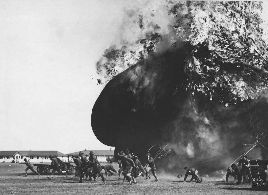 At Fort Sill, the ground crew run from the flames of a burning observation balloon, Lawton, Oklahoma, April 2, 1918. Photo: PhotoQuest/Getty Images
