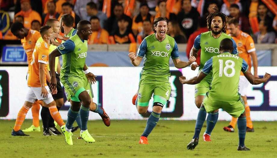 Seattle Sounders defender Gustav Svensson (4) and  defender Kelvin Leerdam (18) celebrate Svensson's goal against the Houston Dynamo during the first half of the MLS Western Conference Finals at BBVA Compass Stadium on Tuesday, Nov. 21, 2017, in Houston. ( Brett Coomer / Houston Chronicle ) Photo: Brett Coomer, Staff / © 2017 Houston Chronicle