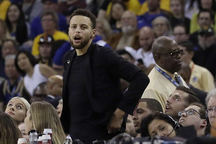 Injured Golden State Warriors guard Stephen Curry watches from the bench during the first half of the team's NBA basketball game against the Utah Jazz in Oakland, Calif., Wednesday, Dec. 27, 2017. (AP Photo/Jeff Chiu) Photo: Jeff Chiu, Associated Press