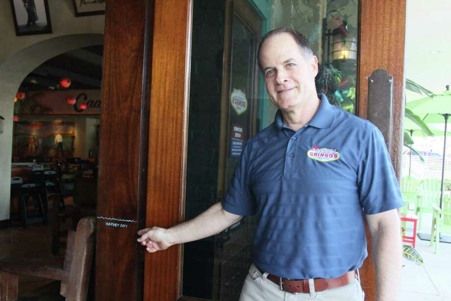 Gringo's Mexican Kitchen in Spring reopened in December after extensive renovations frombeing closed due to flooding fromHurricane Harvey. The painted line on the inside of the doorway entrance indicates how high the water reached. Franchisee Joel Perkins points to a line that indicates the height of the floodwaters caused by Hurricane Harvey in August. Photo: Mayra Cruz