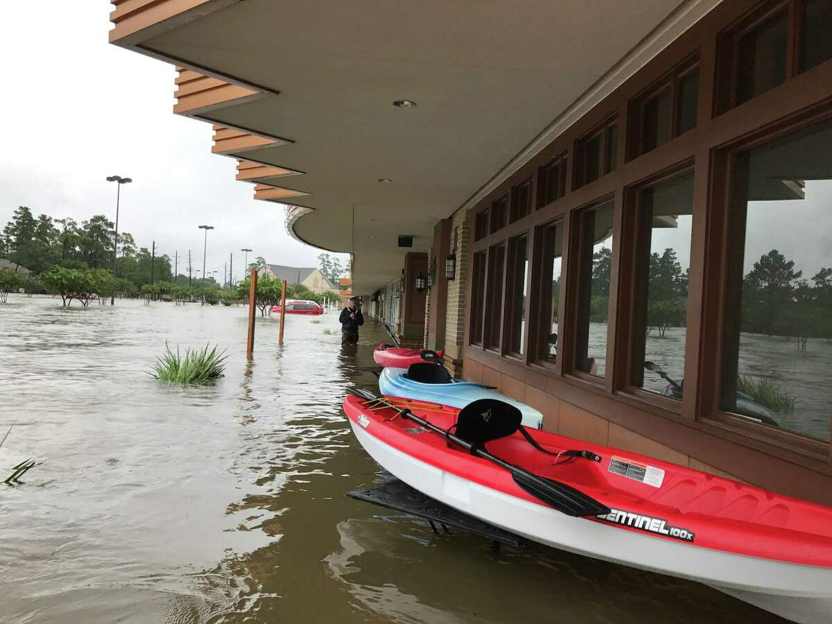 Gringo's Mexican Kitchen franchisee Joel Perkins used a canoe to check on the status of the restaurant during Hurricane Harvey.