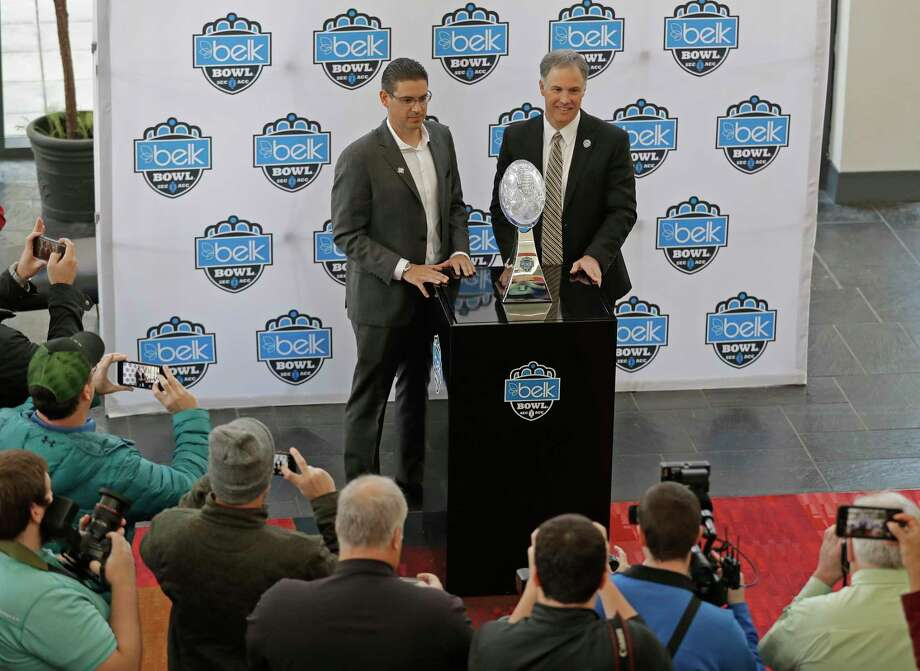Wake Forest head coach Dave Clawson, right, and Texas A&M interim head coach Jeff Banks, left, pose with the trophy during media day for the Belk Bowl NCAA college football game in Charlotte, N.C., Thursday, Dec. 28, 2017. (AP Photo/Chuck Burton) Photo: Chuck Burton, STF / Copyright 2017 The Associated Press. All rights reserved.