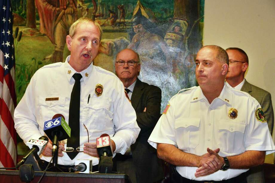 Saratoga Springs Fire Chief Robert Williams, left, and assistant Police Chief John Catone announces that their investigations have found that last July's Woodlawn Ave fire was arson during a news conference Tuesday Oct. 29, 2013, in Saratoga Springs, NY.  (John Carl D'Annibale / Times Union) Photo: John Carl D'Annibale, Albany Times Union / 00024427A