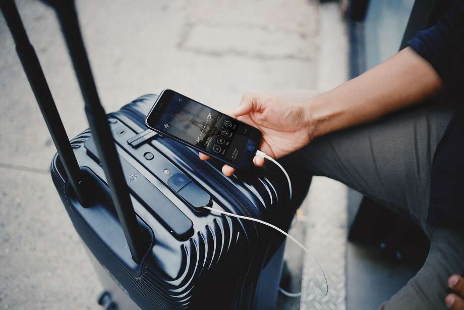 The Bluesmart Series 2 roll-aboard bag. Because of the possibility of fire, airlines increasingly are banning luggage that has a built-in battery from being checked. Photo: Bluesmart