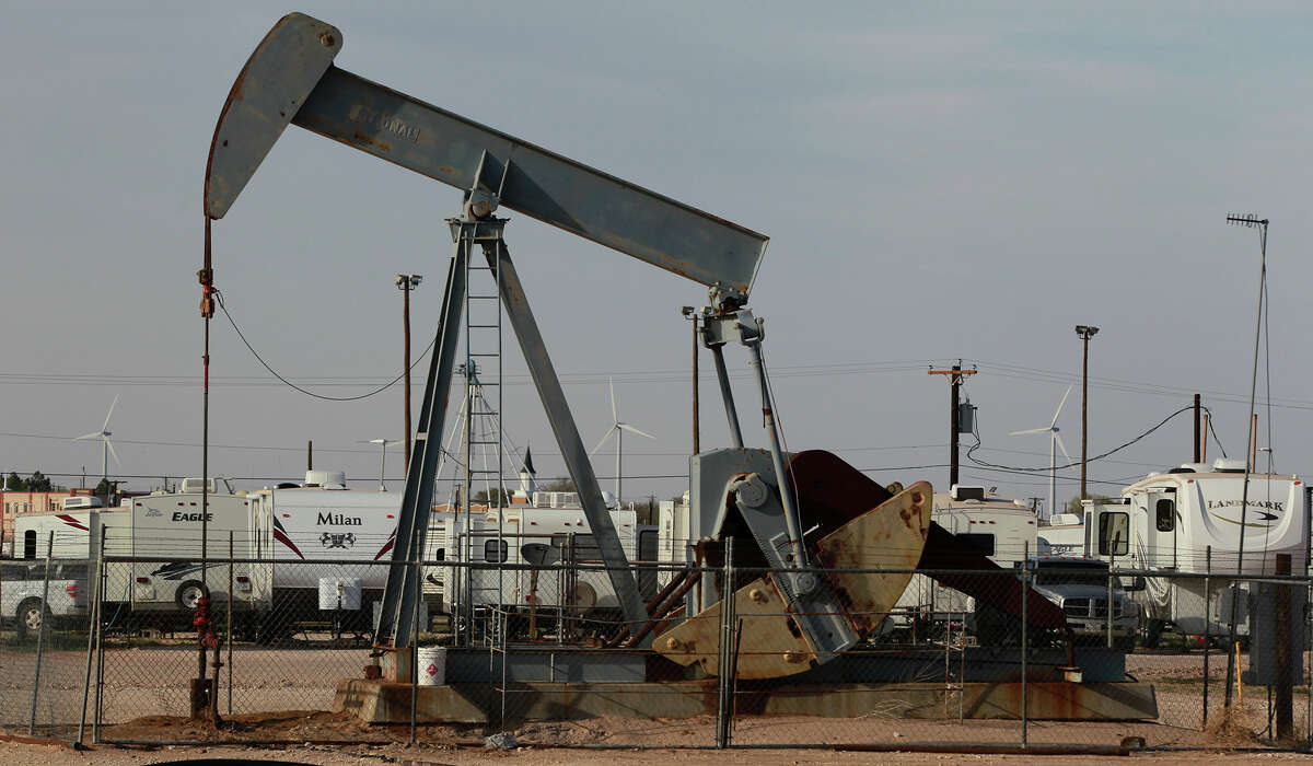 A pumpjack rocks back and forth Wednesday April 2, 2014 in Stanton, Texas next to the Permian Basin Golf & RV Park where people in the petroleum industry live.