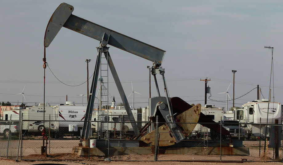 A pumpjack rocks back and forth Wednesday April 2, 2014 in Stanton, Texas next to the Permian Basin Golf & RV Park where people in the petroleum industry live. Photo: JOHN DAVENPORT/SAN ANTONIO EXPRESS-NEWS