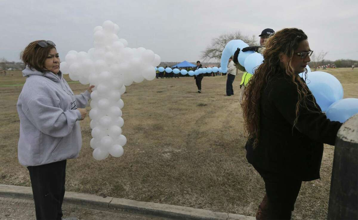 Jessica Craven (right), president of non-profit Benjamin's Right Hand and Josie Soto (left) prepare balloons during a funeral service for six-year-old Kameron Prescott on Thursday, Dec. 28, 2017. Kameron was killed in his Schertz trailer home by Bexar County sheriff's deputies' gunfire last week. About 600 people attended the service which was held at United Methodist Church in Universal City and his burial followed at Chapel Hill Memorial Park. (Kin Man Hui/San Antonio Express-News)
