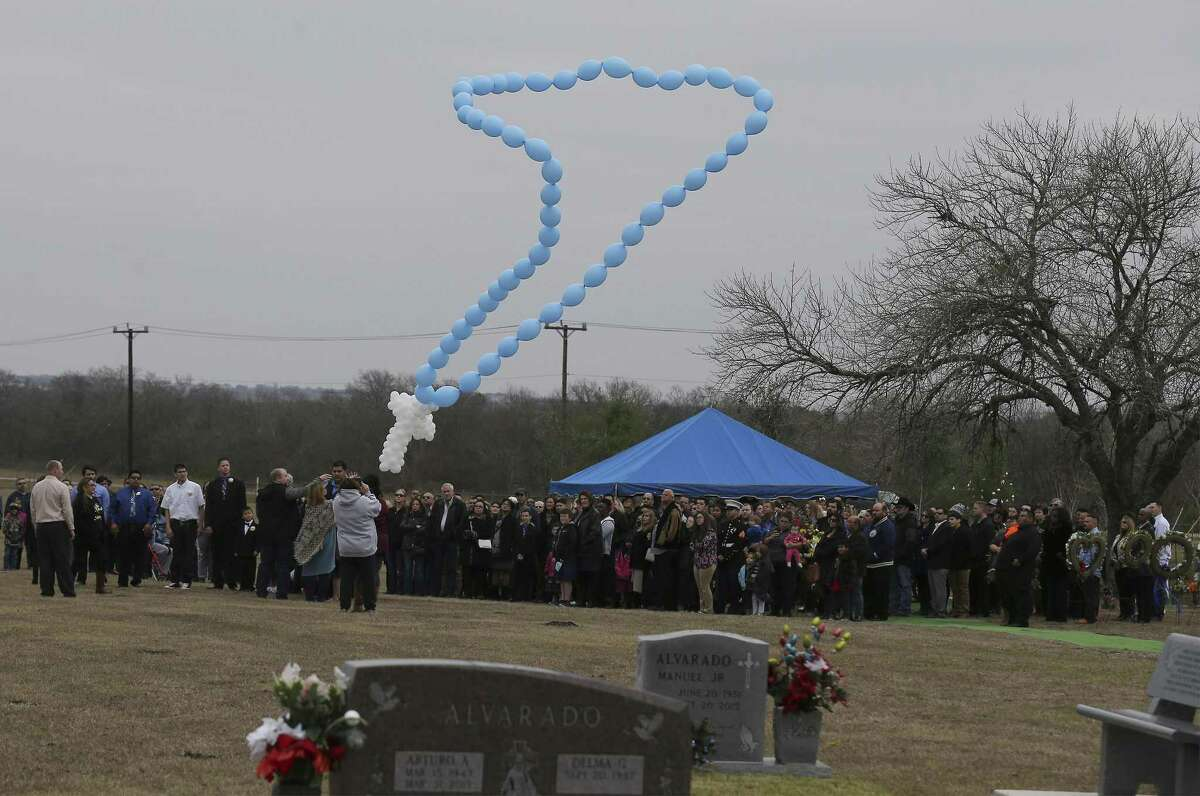 Family members release balloons in the shape of a rosary chain during the service for Kameron Prescott, 6, who was killed in his Schertz mobile home by Bexar County sheriff's deputies' gunfire. The burial took place at Chapel Hill Memorial Park.