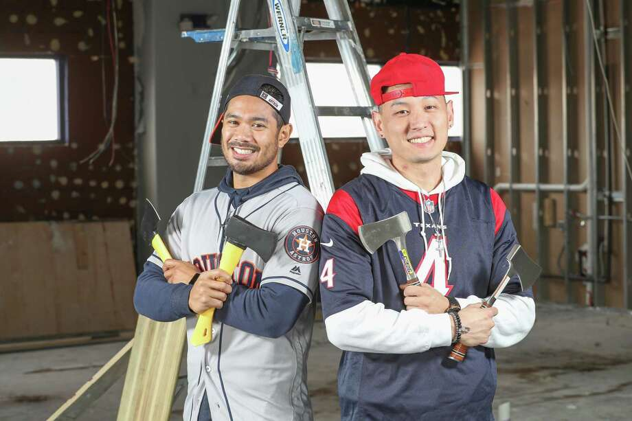 """AJ Gulla and Stephen Jung are looking to convert a former nightclub into a roughly 1,800-square-foot ax-throwing range. """"There's sort of an adrenaline rush"""" to the sport, Gullo says.  Photo: Steve Gonzales, Houston Chronicle / © 2017 Houston Chronicle"""
