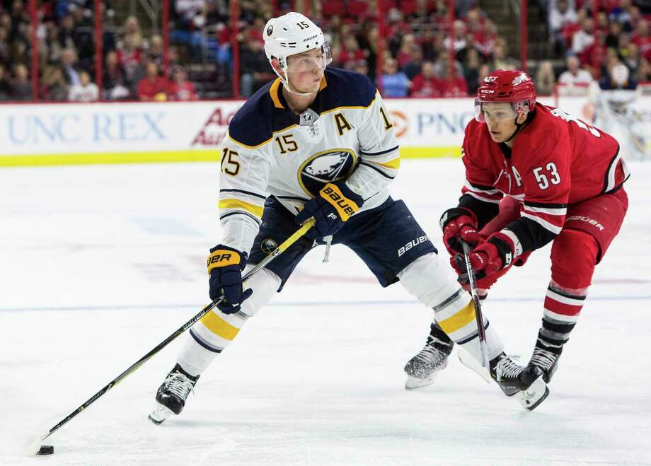 Buffalo Sabres' Jack Eichel (15) handles the puck ahead of Carolina Hurricanes' Jeff Skinner (53) during the first period of an NHL hockey game in Raleigh, N.C., Saturday, Dec. 23, 2017. (AP Photo/Ben McKeown) Photo: Ben McKeown / FR171414 AP