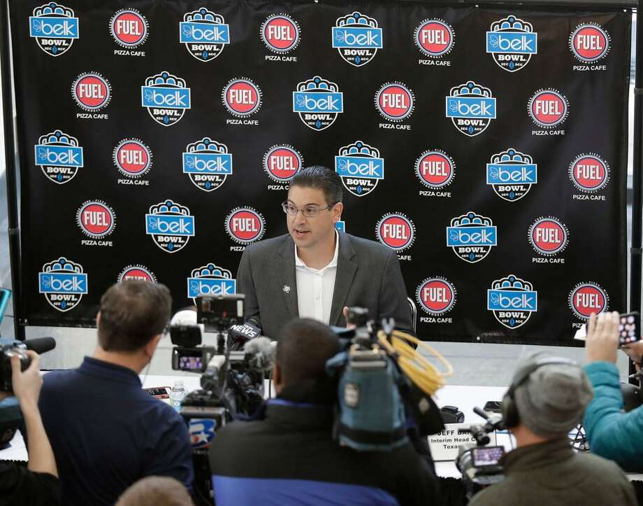 Texas A&M interim head coach Jeff Banks answers a question during media day for the Belk Bowl NCAA college football game in Charlotte, N.C., Thursday, Dec. 28, 2017. Photo: Chuck Burton /AP Photo