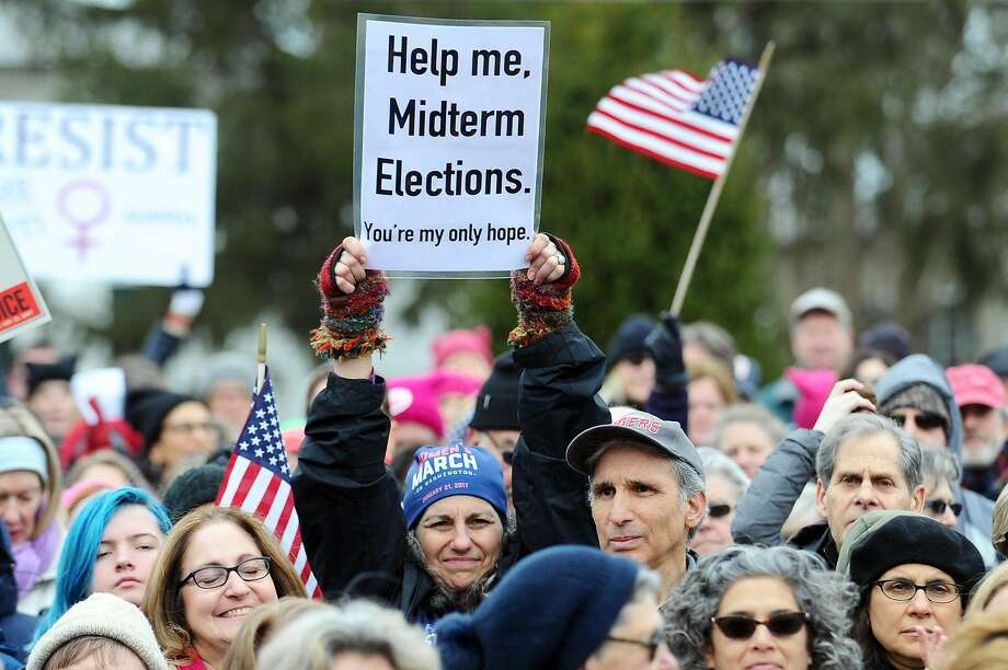 """Hundreds marched on the MOVE's """"A March to Defend Democracy,"""" in Westport, Conn. on March 26, 2017. Photo: Michael Cummo, Hearst Connecticut Media"""