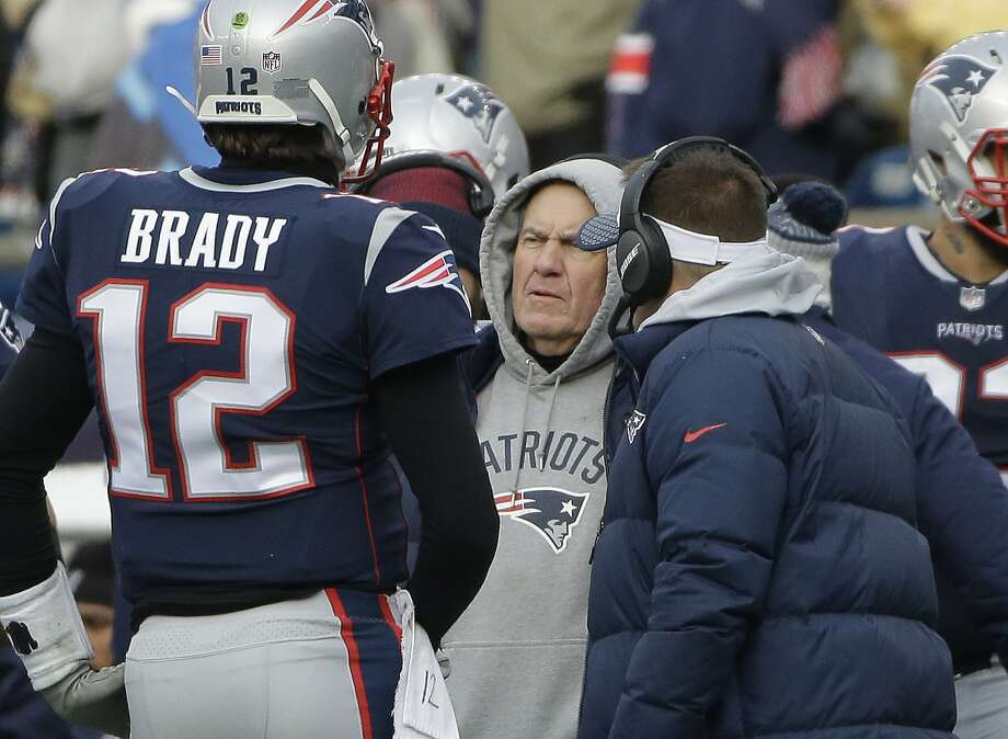 New England Patriots head coach Bill Belichick speaks to quarterback Tom Brady during a timeout in the first half of an NFL football game in Foxborough, Mass.  Photo: Steven Senne, Associated Press