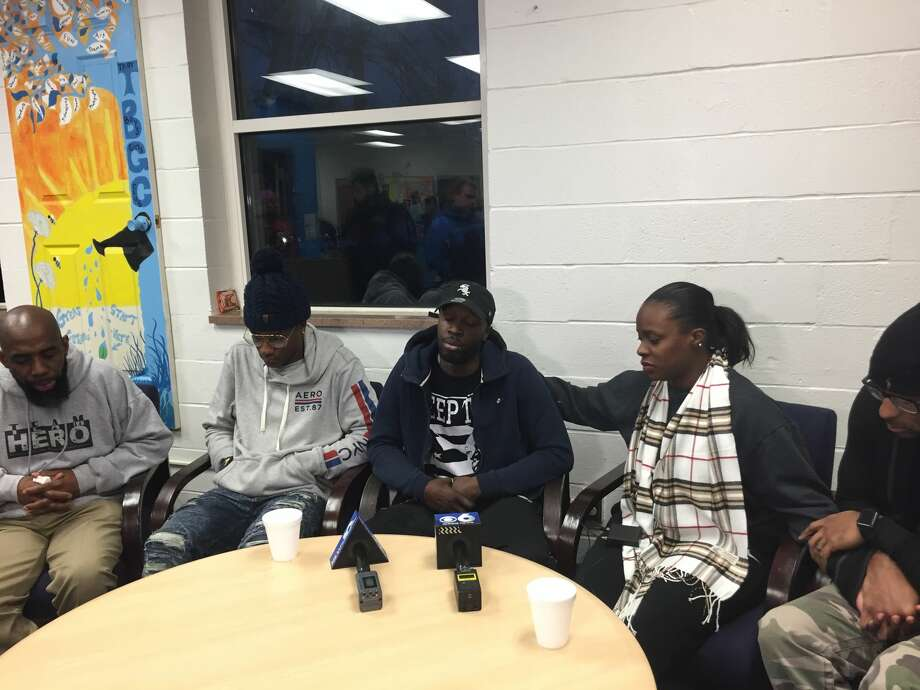 Family and friends of the four people found killed in a Lansingburgh basement apartment the day after Christmas gathered at the Troy Boy & Girls Club on Thursday, Dec. 28, 2017, to remember the victims.Photographed (left to right) are Jerry Ford, a volunteer coordinator for the Troy Boys & Girls Club; Isaiah Smith, 15, who is the son of Shanta Myers, one of the victims; Khalif Coleman, a nephew of Shanta Myers; Shakera Symes, Shanta Myers' sister; and Alphonso Dukes, Symes' husband. Photo: Amanda Fries / Times Union
