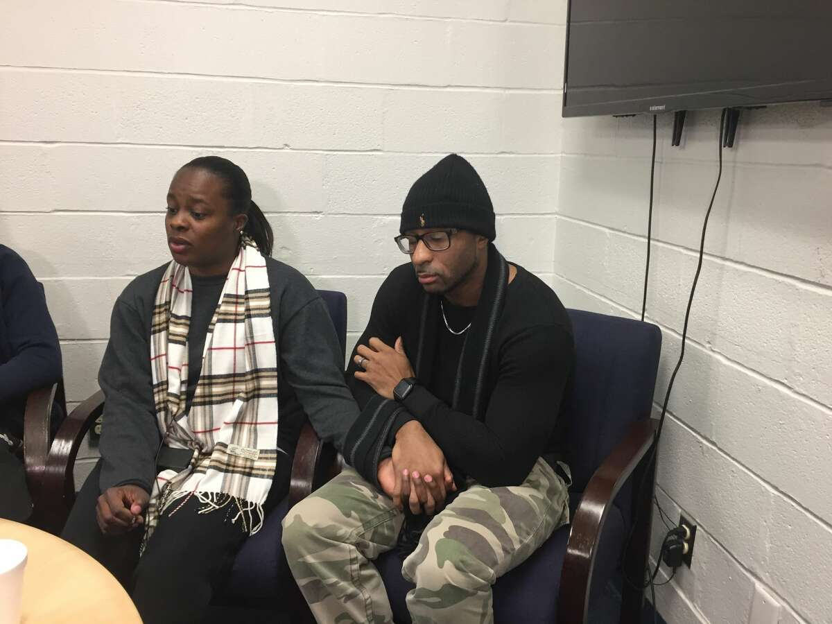 Shakera Symes, left, and her husband Alphonso Dukes, talk about Symes' sister Shanta Myers at the Troy Boy & Girls Club on Thursday, Dec. 28, 2017. Myers, her two children and her partner were found killed inside a Troy apartment the day after Christmas.