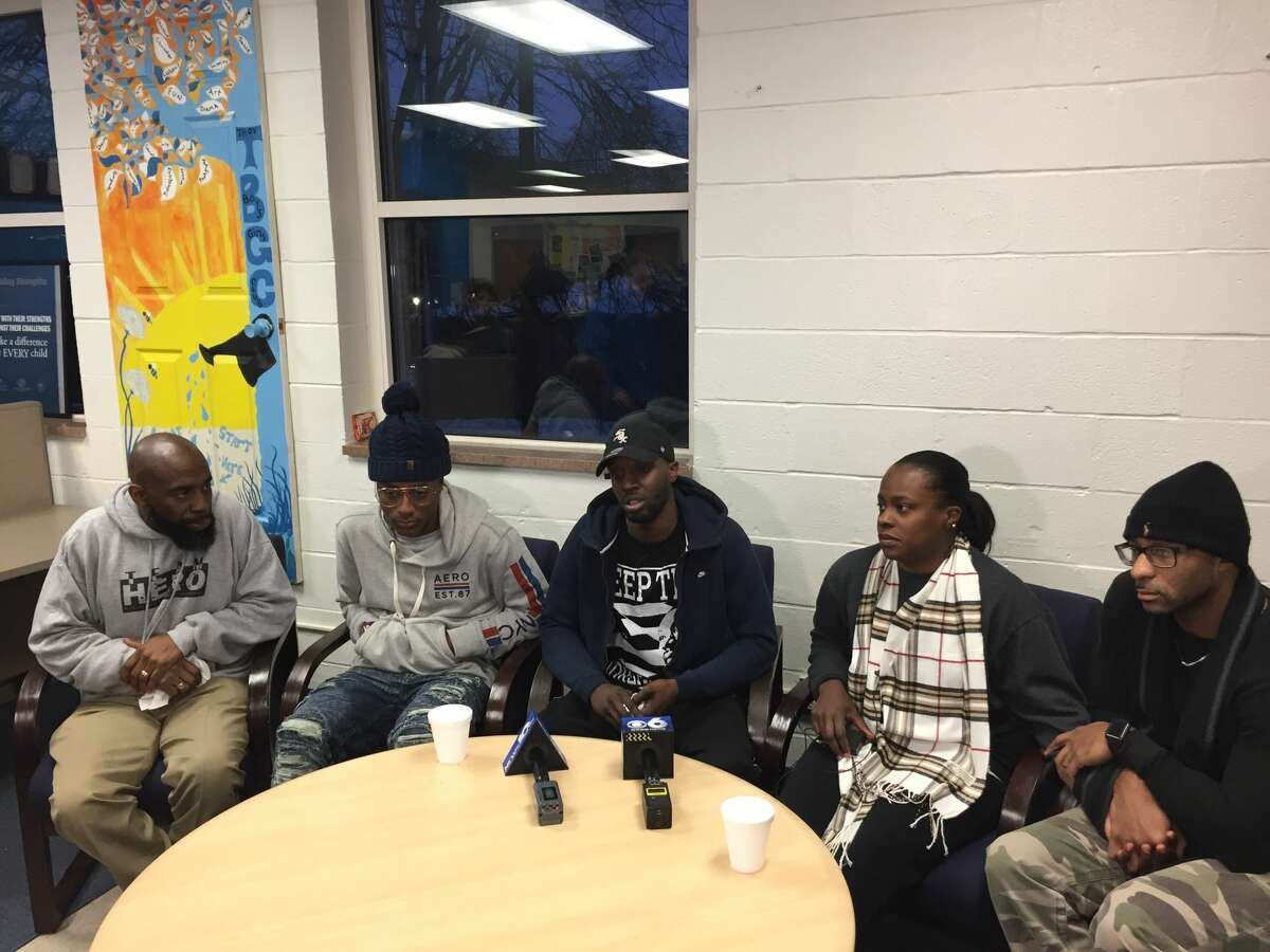 Family and friends of the four people found killed in a Lansingburgh basement apartment the day after Christmas gathered at the Troy Boy & Girls Club on Thursday, Dec. 28, 2017, to remember the victims.Photographed (left to right) are Jerry Ford, a volunteer coordinator for the Troy Boys & Girls Club; Isaiah Smith, 15, who is the son of Shanta Myers, one of the victims; Khalif Coleman, a nephew of Shanta Myers; Shakera Symes, Shanta Myers' sister; and Alphonso Dukes, Symes' husband.