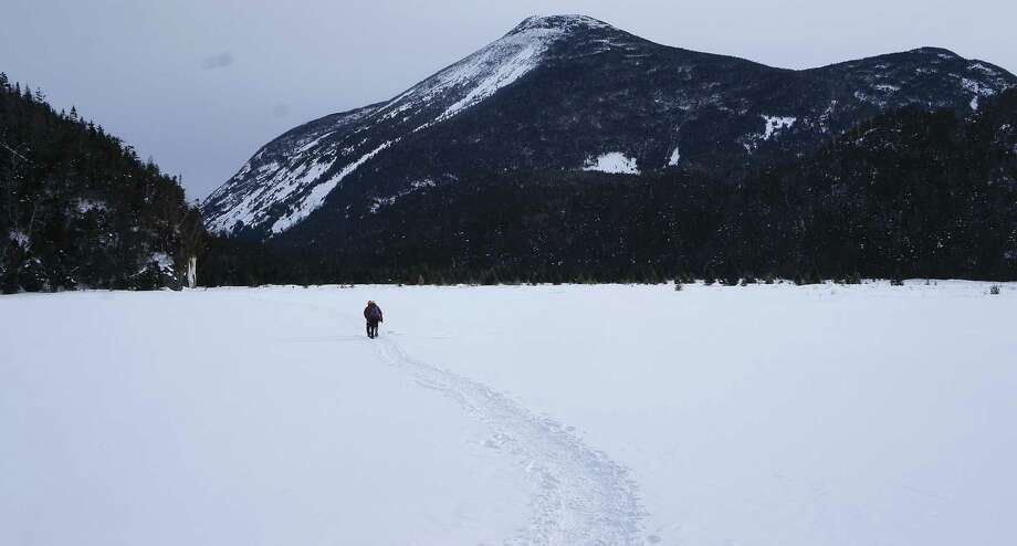 A hiker makes his way across the Flowed Lands with Mount Colden behind him in this 2015 photo. (Herb Terns / Times Union) Photo: Picasa