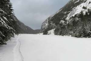 A snowshoe trench across Avalanche Lake in the Adirondack High Peaks. (Herb Terns / Times Union)