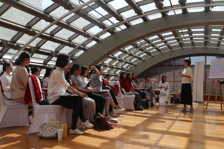 Women in Didi Chuxing's leadership program for women attend a workshop on how to better handle challenges in work and life. Photo: DiDi Chuxing