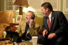 Midland Development Corp. Chairmant Brent Hilliard, left, and City Councilman J.Ross Lacy look over early voting results for the road bond on Nov. 7. The men are being recognized as Newsmakers of the Year for their efforts in leading a successful campaign and their overall impact on the community.