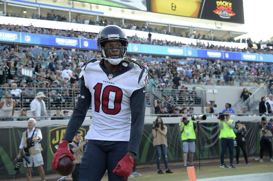 Wide receiver DeAndre Hopkins isn't expected to play Sunday, ending his streak of 79 straight games. Photo: Phelan M. Ebenhack / Associated Press / FR121174 AP